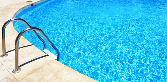 swimming pool with clear water and entry ladder